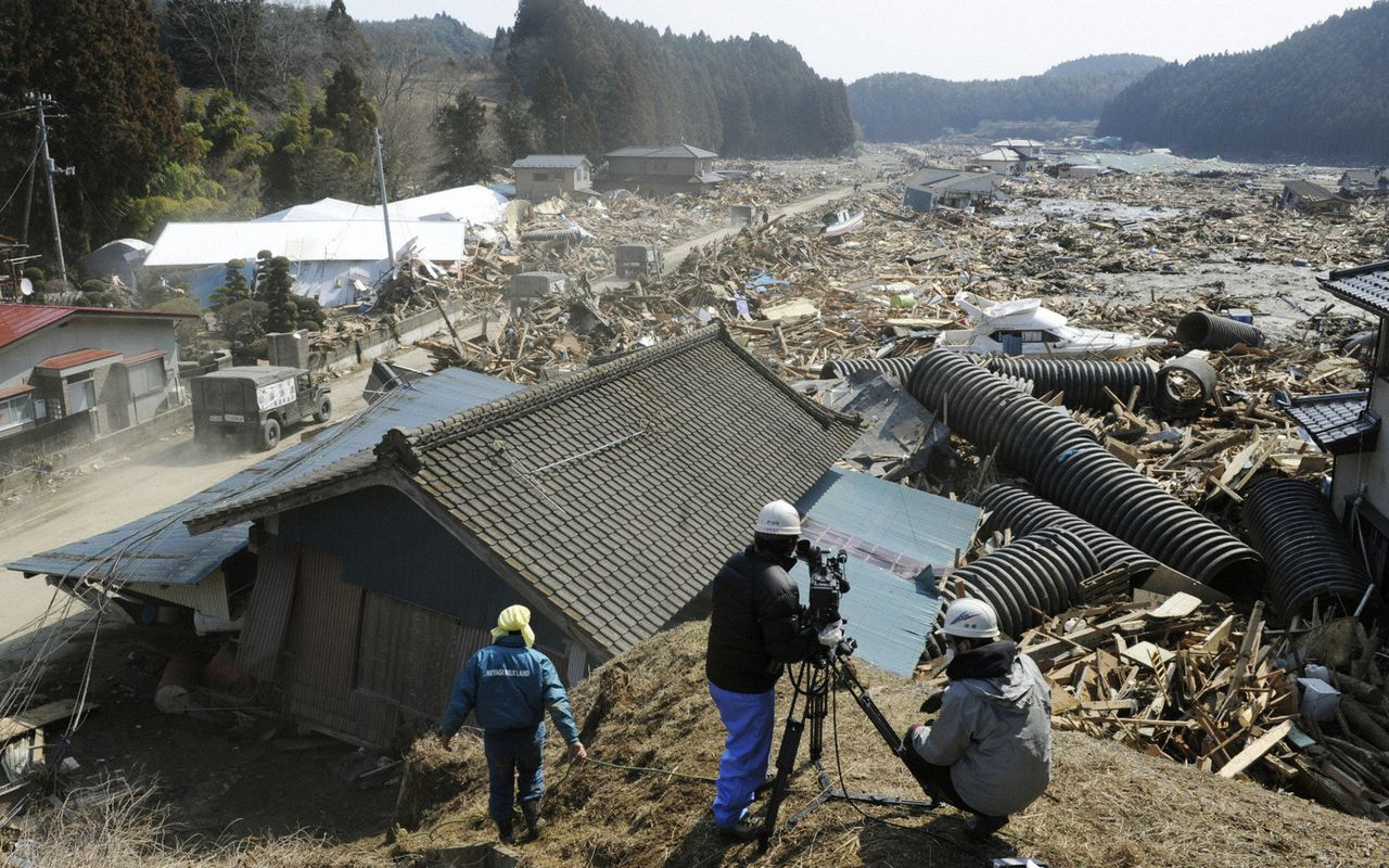 A news crew films the destruction caused by a tsunami in Minamisanriku, Miyagi Prefecture, in northern Japan after the magnitude 8.9 earthquake struck the area, March 13, 2011. REUTERS/Kyodo (JAPAN - Tags: DISASTER ENVIRONMENT MEDIA) FOR EDITORIAL USE ONLY. NOT FOR SALE FOR MARKETING OR ADVERTISING CAMPAIGNS. THIS IMAGE HAS BEEN SUPPLIED BY A THIRD PARTY. IT IS DISTRIBUTED, EXACTLY AS RECEIVED BY REUTERS, AS A SERVICE TO CLIENTS. JAPAN OUT. NO COMMERCIAL OR EDITORIAL SALES IN JAPAN. YES