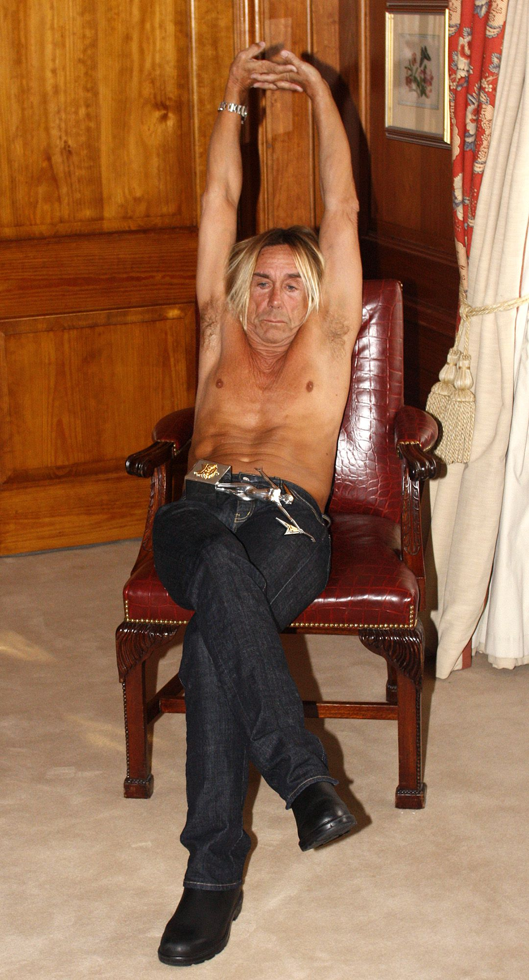 U.S. musician Iggy Pop poses for photographers during a photo call in London, Sunday, Nov. 1, 2009, to celebrate receiving the Living Legend Award ahead of the Classic Rock Roll of Honor on Nov. 2. (AP Photo/Akira Suemori)