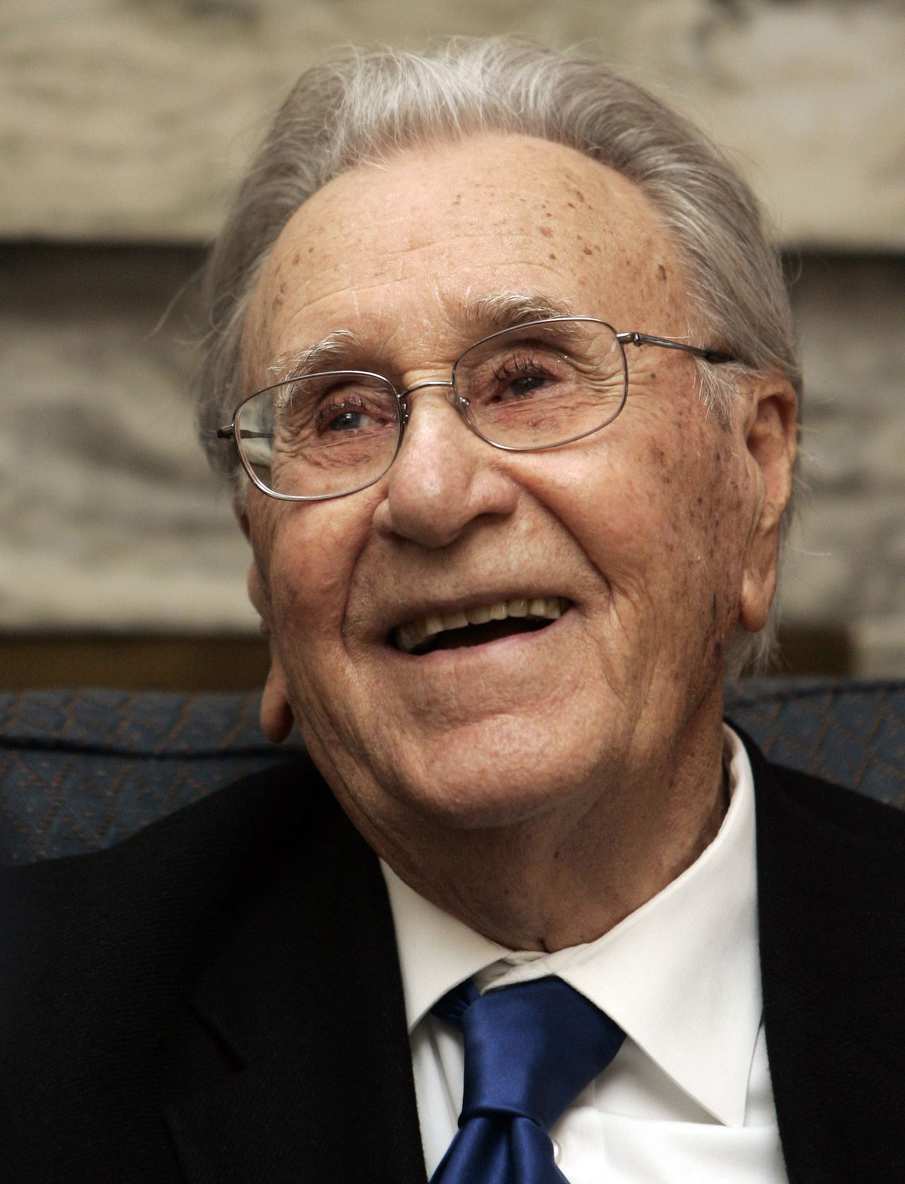 FILE - In this Thursday, May 7, 2009 file photo Evangelist Oral Roberts smiles after being honored on the floor of the Oklahoma Senate in Oklahoma City. A spokesman for Oral Roberts on Tuesday, Dec. 15, 2009 said the evangelist and university founder has died at age 91. (AP Photo/File)