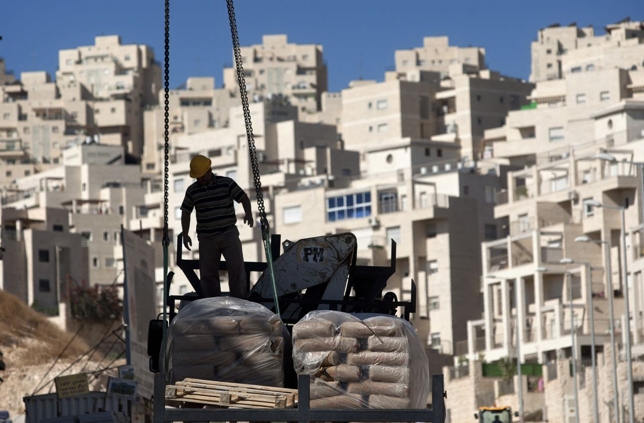 A construction worker works on a new housing unit in the east Jerusalem neighborhood of Har Homa, Wednesday, Nov. 2, 2011. Israel announced late Tuesday that it has ordered accelerated construction of 2,000 new apartments for Israelis in east Jerusalem, the section claimed by the Palestinians as their capital, and nearby West Bank settlements. (AP Photo/Sebastian Scheiner)
