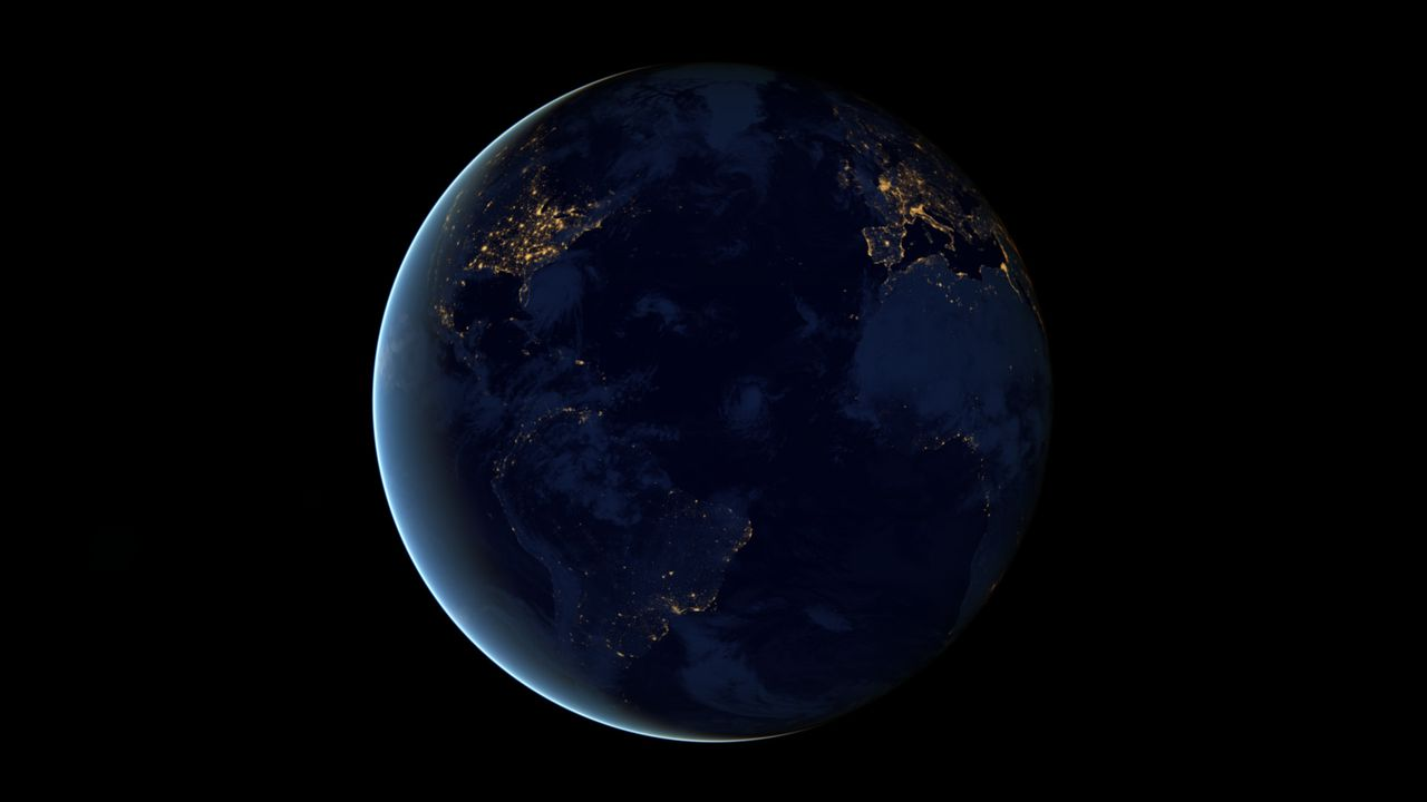 """The night side of Earth twinkles with light, and the first thing to stand out is the cities. """"Nothing tells us more about the spread of humans across the Earth than city lights,"""" asserts Chris Elvidge, a NOAA scientist who has studied them for 20 years. This new global view and animation of Earth's city lights is a composite assembled from data acquired by the Suomi National Polar-orbiting Partnership (Suomi NPP) satellite. The data was acquired over nine days in April 2012 and thirteen days in October 2012. It took satellite 312 orbits and 2.5 terabytes of data to get a clear shot of every parcel of Earth's land surface and islands. This new data was then mapped over existing Blue Marble imagery of Earth to provide a realistic view of the planet. The nighttime view in visible light was made possible by the new """"day-night band"""" of Suomi NPP's Visible Infrared Imaging Radiometer Suite. VIIRS detects light in a range of wavelengths from green to near-infrared and uses filtering techniques to observe dim signals such as city lights, auroras, wildfires, and reflected moonlight. This low-light sensor can distinguish night lights with ten to hundreds of times better light detection capability than scientists had before. Named for satellite meteorology pioneer Verner Suomi, NPP flies over any given point on Earth&rsquos surface twice each day at roughly 1:30 a.m. and 1:30 p.m. The polar-orbiting satellite flies 824 kilometers (512 miles) above the surface as it circles the planet 14 times a day. Data is sent once per orbit to a ground station in Svalbard, Norway, and continuously to local direct broadcast users around the world. The mission is managed by NASA with operational support from NOAA and its Joint Polar Satellite System, which manages the satellite's ground system. NASA Earth Observatory image and animation by Robert Simmon, using Suomi NPP VIIRS data provided courtesy of Chris Elvidge (NOAA National Geophysical Data Center). Suomi NPP is the result of a partners"""