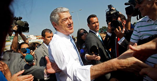Caption: Portuguese interim Prime Minister Jose Socrates greets people during the opening of the last stretch of a Lisbon ring road Saturday, April 16, 2011, in the outskirts of the capital. Socrates who resigned after opposition parties rejected his government's debt-reduction plan will run in the general elections to be held June 5.