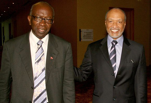Caption: FILE - In this May 10, 2011 file picture Mohamed bin Hammam, right, of Qatar, chief of the Asian Football Confederation, is accompanied by FIFA Vice President Austin Jack Warner, of Trinidad & Tobago, during a meeting in Port of Spain, Trinidad & Tobago. FIFA suspended Mohamed bin Hammam and Jack Warner on Sunday May 29, 2011 amid allegations the two executive committee members bribed voters in the presidential election campaign. The FIFA ethics committee, meanwhile, cleared FIFA president Sepp Blatter of turning a blind eye to the alleged bribes. The decision clears the way for Blatter to be re-elected unopposed to a fourth term on Wednesday. FIFA said bin Hammam, a Qatari who heads Asia's football confederation, and Warner, a FIFA vice president from Trinidad, will now face a full FIFA inquiry. If found guilty, they could be expelled from FIFA and banned from all football activity. (AP Photo/Shirley Bahadur,File)
