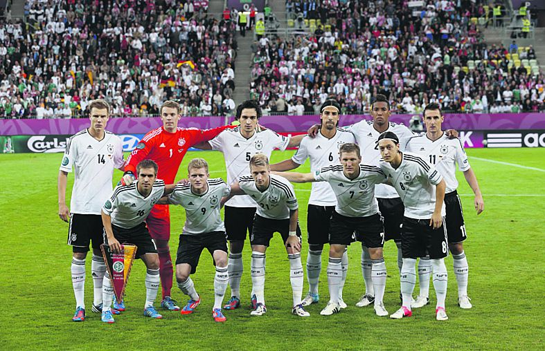 Standing left to right are Germany's Holger Badstuber, goalkeeper Manuel Neuer, Mats Hummels, Sami Khedira, Jerome Boateng, Miroslav Klose, and front left to right are Philipp Lahm, Andre Schuerrle, Marco Reus, Bastian Schweinsteiger, and Mesut Oezil during the Euro 2012 soccer championship quarterfinal match between Germany and Greece in Gdansk, Poland, Friday, June 22, 2012. (AP Photo/Jon Super)
