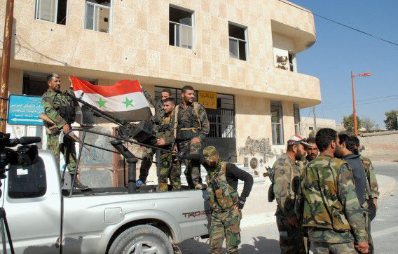 epa03922708 A handout picture made available by the Syrian Arab News Agency (SANA) shows Syrian army soldiers patrolling in Htaitet al-Turkman in rural Damascus, Syria, 24 October 2013. At least 50,000 regime troops have been killed in Syria since the crisis started in March 2011, according to the Britain-based Observatory, which said it had documented 30,000 such deaths. EPA/SANA / HANDOUT HANDOUT EDITORIAL USE ONLY/NO SALES