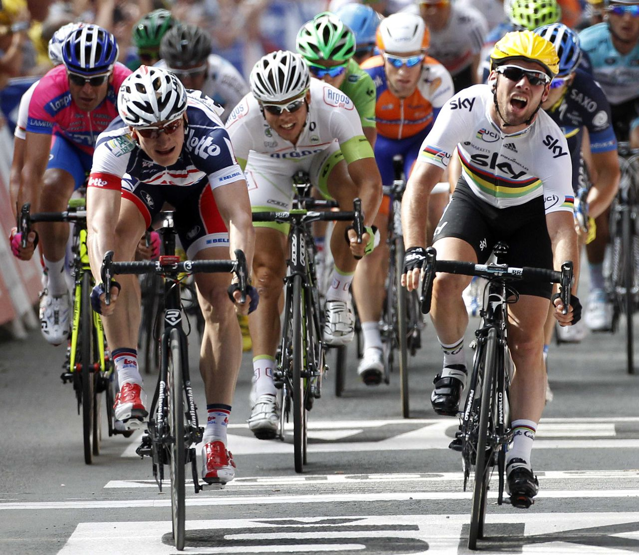 Sky Procycling rider Mark Cavendish of Britain (R) sprints ahead of Lotto-Belissol Team rider Andre Greipel (L) as he wins the second stage of the 99th Tour de France cycling race between Vise and Tournai, July 2, 2012. REUTERS/Jean-Paul Pelissier (BELGIUM - Tags: SPORT CYCLING)