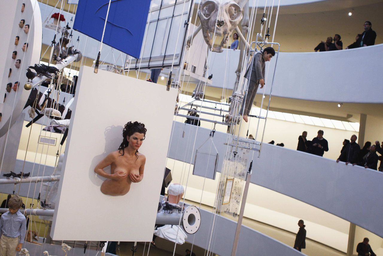 """Installations, part of the retrospective """"Maurizio Cattelan: All"""" by Italian artist Maurizio Cattelan, are seen at the Guggenheim Museum in New York November 4,2011. The display of 128 works hangs from the rotunda of the museum. REUTERS/Shannon Stapleton (UNITED STATES - Tags: SOCIETY) TEMPLATE OUT"""