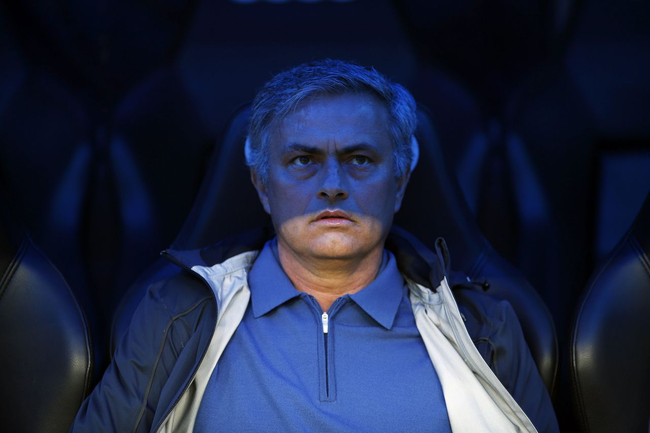 Real Madrid's coach Jose Mourinho waits for the start of their Spanish first division soccer match against Real Valladolid at Santiago Bernabeu stadium in Madrid May 4, 2013. REUTERS/Susana Vera (SPAIN - Tags: SPORT SOCCER TPX IMAGES OF THE DAY)