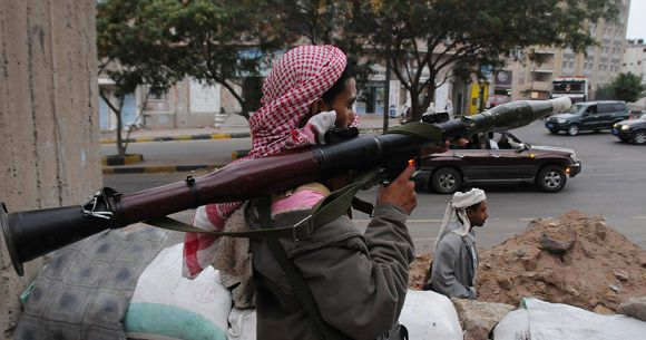 Caption: An opposition follower holds a rocket-propelled grenade launcher (RPG) as he secures a street leading to an opposition stronghold in the southern Yemeni city of Taiz August 13, 2011. REUTERS/Stringer (YEMEN - Tags: POLITICS CIVIL UNREST CONFLICT)