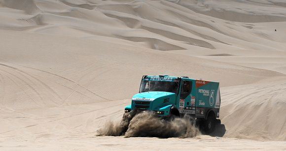 Caption: Iveco's driver Gerard de Rooij and co-driver Tom Colsoul, both from The Netherlands, compete during the 12th stage of the 2012 Argentina-Chile-Peru Dakar Rally between Arequipa and Nazca in Peru, Friday, Jan. 13, 2012. (AP Photo/Martin Mejia)