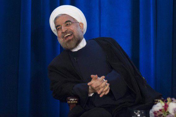 Een lachende Iraanse president Hassan Rohani tijdens een evenement van de Council on Foreign Relations en de Asia Society in New York gisteren.