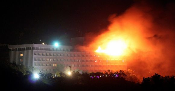 Caption: Smoke and flames rise from the Intercontinental hotel during a battle between NATO-led forces and suicide bombers and Taliban insurgents in Kabul June 29, 2011. Afghan police sifted through one of Kabul's landmark hotels room by room on Wednesday for any more casualties or security threats after an overnight assault by Taliban suicide bombers killed 10 Afghan civilians and police. The eight attackers, armed with rocket-propelled grenades and other weapons, stormed the heavily guarded Intercontinental hotel, frequented by Westerners and VIPs, before a NATO helicopter killed the remaining insurgents in a final rooftop battle that ended a raid lasting more than five hours. REUTERS/Stringer (AFGHANISTAN - Tags: CIVIL UNREST POLITICS IMAGES OF THE DAY)