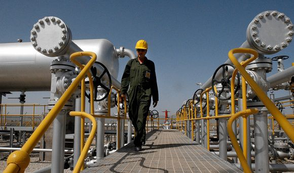Caption: FILE - In this Tuesday, April 15, 2008 file photo Iranian oil technician Majid Afshari makes his way to the oil separator facilities in Iran's Azadegan oil field southwest of Tehran, Iran. The market is so flush with oil at the moment that even the loss of more Iranian crude from the market may not lead to short supplies and higher prices. In fact, if Iran figures out a way to get around the sanctions and get more of its oil to market, oil prices could fall further. (AP Photo/Vahid Salemi, File)