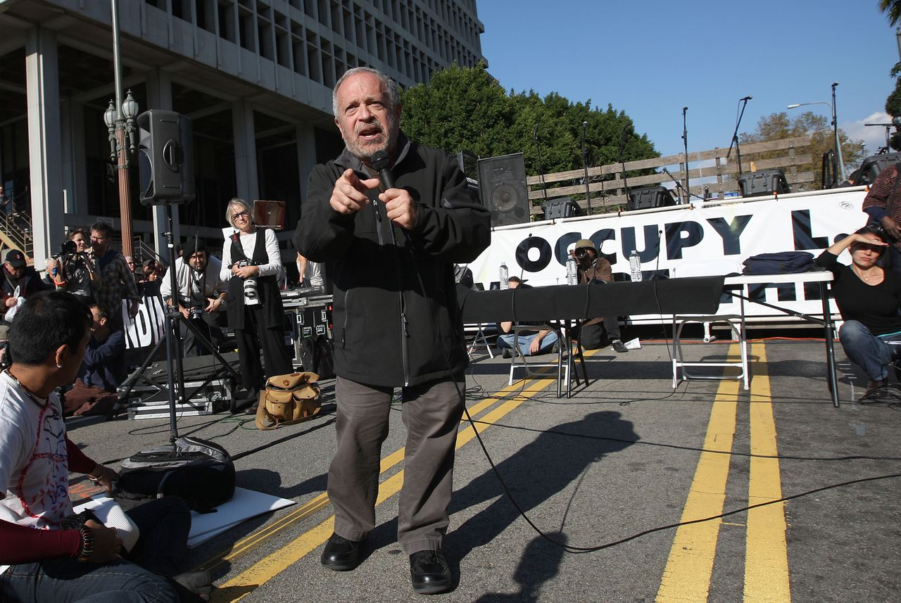 LOS ANGELES, CA - NOVEMBER 5: Former U.S. Secretary of Labor Robert Reich speaks to Occupy Los Angeles protesters after the Move Your Money March through the downtown financial district during what is being called Bank Transfer Day, on November 5, 2011 in Los Angeles, California. Occupy movement members are calling for people to move their money from banks to credit unions today in support of the 99% movement. David McNew/Getty Images/AFP == FOR NEWSPAPERS, INTERNET, TELCOS & TELEVISION USE ONLY ==