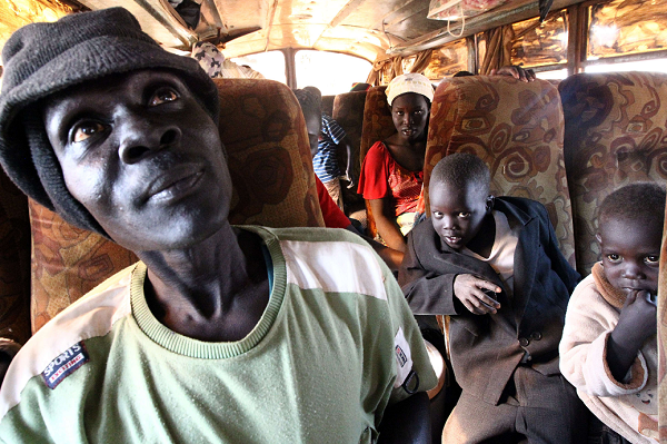 Sudanese families sit in a bus bound for south Sudan in al-Analdus area in the outskirts of the capital of Khartoum on January 6, 2011 as displaced southerners return to their homeland from the north ahead of a key referendum on south Sudan's independence