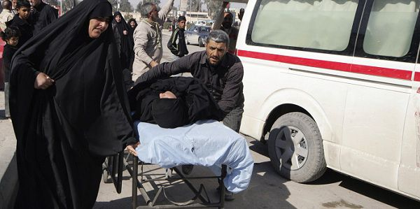 Residents wheel a stretcher carrying a wounded woman after a bomb attack targeted Shi'ite pilgrims commemorating the religious ceremony of Arbain, outside a hospital in Kerbala, 80 km (50 miles) southwest of Baghdad January 24, 2011. Ten people were killed in a second bomb blast targeting Shi'ite pilgrims in the Iraqi city of Kerbala on Monday, bringing the toll for the day to at least 14 as hundreds of thousands took part in a major religious rite, an official said. REUTERS/Mushtaq Muhammed (IRAQ - Tags: RELIGION CIVIL UNREST)