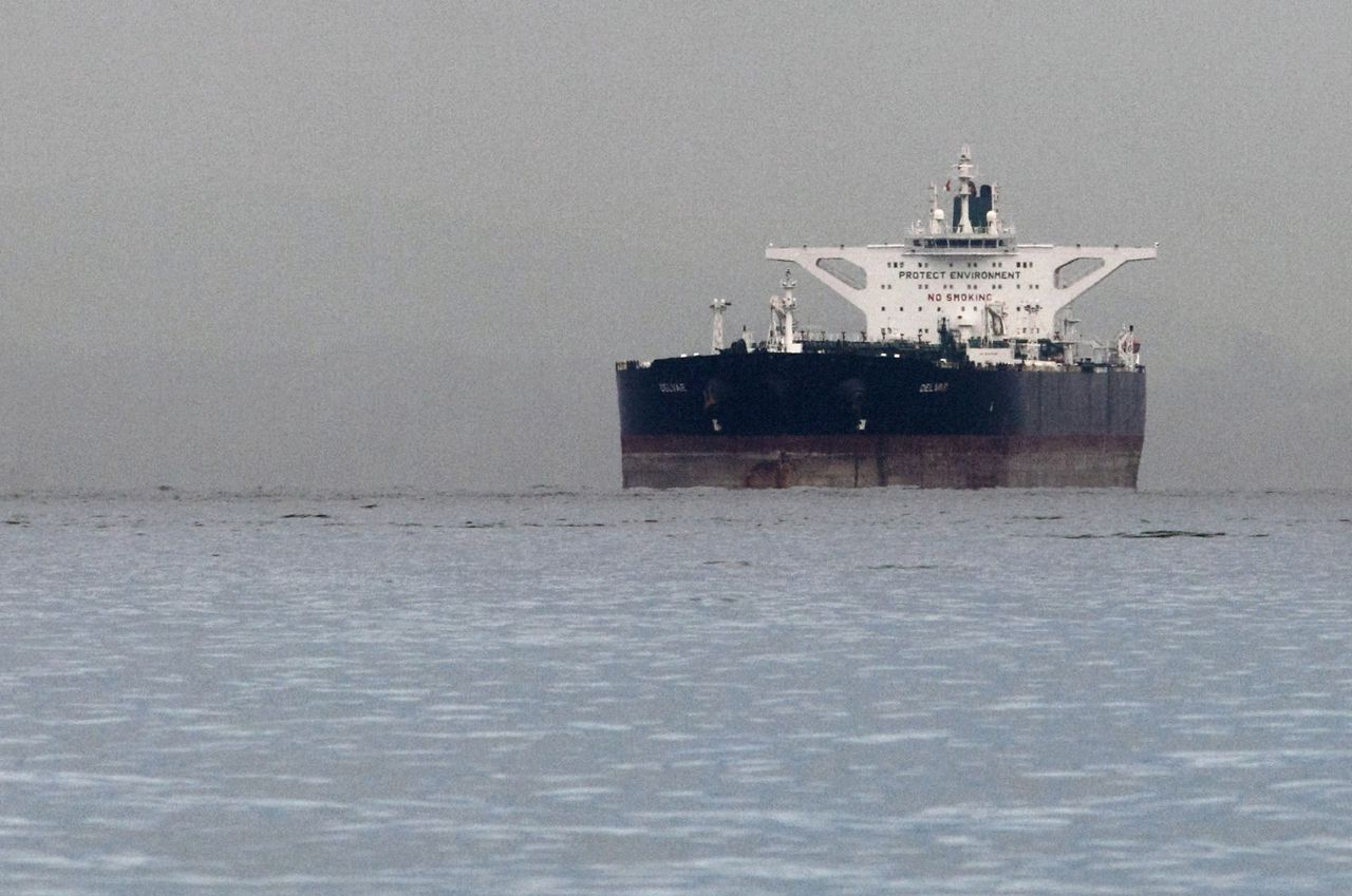 """Malta-flagged Iranian crude oil supertanker """"Delvar"""" is seen anchored off Singapore March 1, 2012. Western trade sanctions against Iran are strangling its oil exports even before they go into effect, a U.S. advisory body has found, amid warnings that any shortages will only push up crude prices and strain a weak global economy. REUTERS/Tim Chong (SINGAPORE - Tags: ENERGY BUSINESS MARITIME TRANSPORT)"""