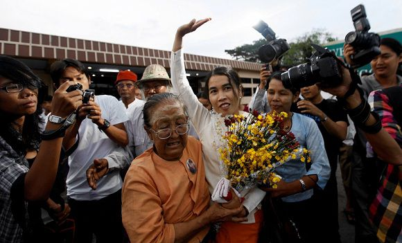 Su Su Nway, a 39-year-old labor activist, arrives at Yangon's domestic airport after being released from prison in this October 16, 2011 file photo. After Myanmar freed about 230 political detainees in a general amnesty on Oct. 12, interviews with inmates offer a glimpse into prison conditions seldom reported during half a century of military rule that ended in March. While a new civilian government embarks on reforms that could slowly open one of the world's most isolated states, its prisons and those still in jail are a reminder of the decades of oppression. To match Insight MYANMAR-PRISONERS/ REUTERS/Soe Zeya Tun (MYANMAR - Tags: POLITICS)