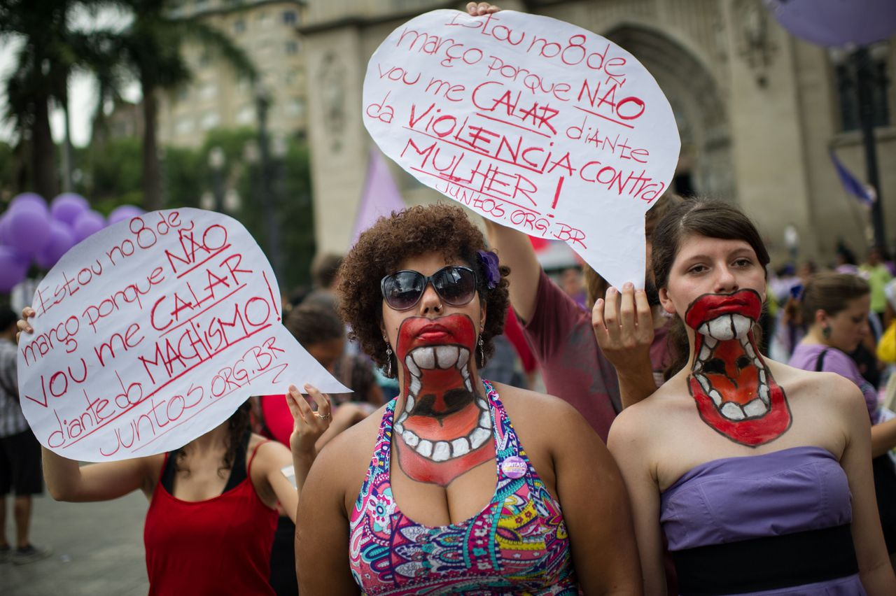 Women with their upper bodies painted pose as they take part in a protest against violence against women during the celebration of the International Women's Day on March 8, 2013, in Sao Paulo, Brazil. AFP PHOTO/YASUYOSHI CHIBA