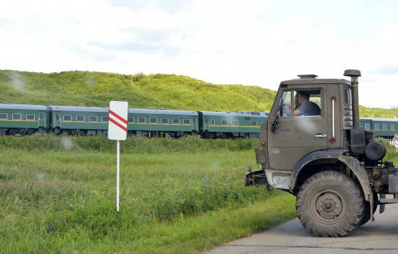 A view through a car window shows the train transporting North Korean leader Kim Jong-il after leaving Khasan station at the border between North Korea and Russia as a truck blocks the road for security purposes, near Russia's far eastern city of Vladivostok August 20, 2011. North Korean leader Kim Jong-il arrived in Russia on a special train on Saturday as the isolated state tries to reach out to regional powers and seek economic aid. REUTERS/Yuri Maltsev (RUSSIA - Tags: POLITICS)