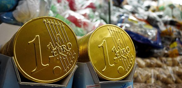 Caption: Chocolate Euro coins are displayed on a stand at Piazza Navona in central Rome, on December 30, 2010. The euro will celebrate its 10th anniversary on January 1, 2012. AFP PHOTO / ANDREAS SOLARO