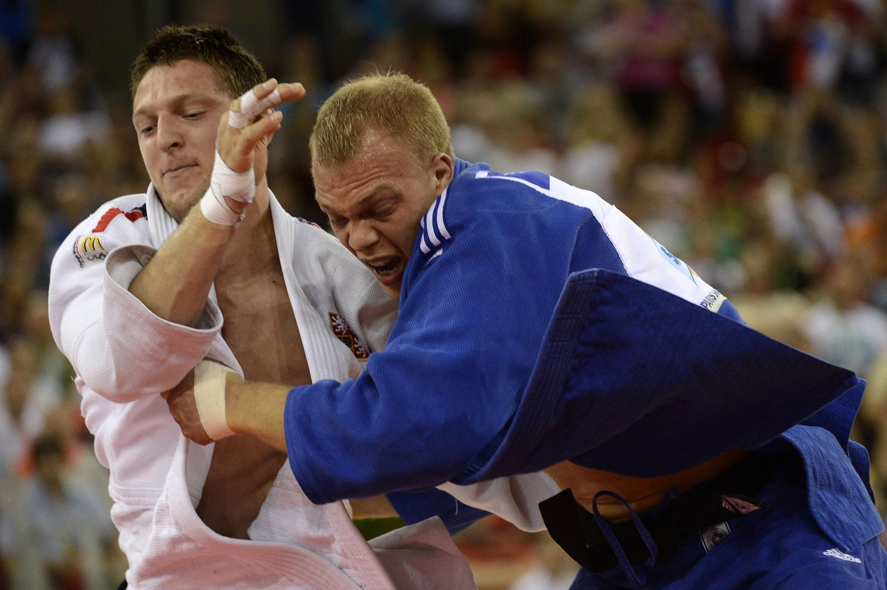 Lukas Krpalek, in white, of the Czech Republic wins against Henk Grol of the Netherlands in the final of men's 100kg category of the 2013 Judo European Championships in Budapest, Hungary, Saturday, April 27, 2013. (AP Photo/MTI, Tamas Kovacs)