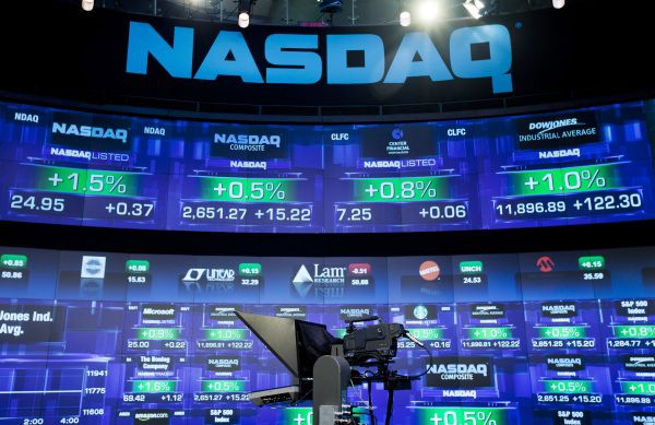 Trading activity is displayed on the electronic board of the Nasdaq MarketSite in New York, U.S., on Friday, March 18, 2011. Photographer: Jin Lee/Bloomberg