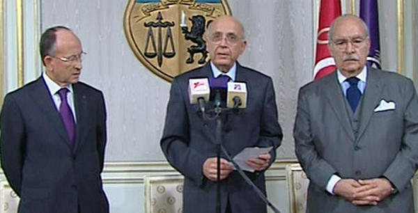 Prime Minister of Tunisia, Mohammed Ghannouchi, centre, appears on state television with other unidentified government members, Friday Jan. 14, 2011, to announce that he is assuming power in Tunisia. The announcement came on Friday after many thousands of protesters mobbed the capital of Tunis to demand the ousting of President Zine El Abidine Ben Ali, and unconfirmed reports said he has left the country. Prime Minister Ghannouchi announced on TV that he will hold power until early elections are held. (AP Photo)