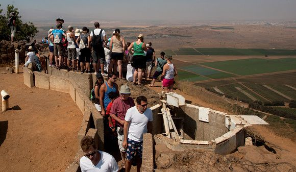 Caption: In this photo taken Monday, July 23, 2012, Israelis are seen at an army post from the 1967 war at Mt. Bental in the Golan Heights, overlooking Syria. Mount Bental is a sought-out overlook these days, shared by boisterous tourists and anxious Israelis hoping to catch a glimpse of the conflict in Syria. (AP Photo/Sebastian Scheiner) IPTC Date: 15:11 23/07/12