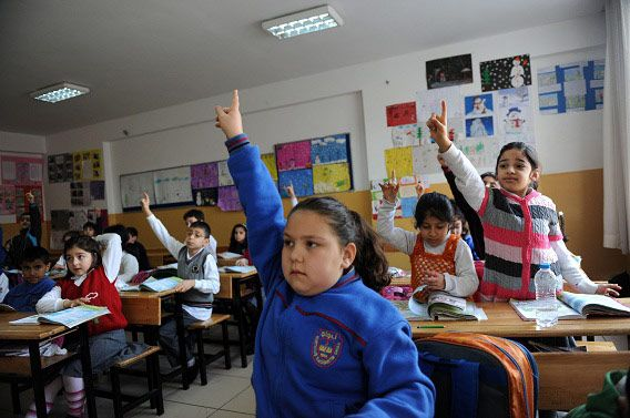 Turkish students attend a lesson at their school in Istanbul on March 23, 2012. Education reforms which would allow parents to put their children in religious schools at 10 have sparked fierce debate on whether they would dent Turkey's secular credentials and even provoked a punch-up in parliament. Under new proposals which could be on the statute book within weeks, children will now be able to taken out of the secondary school system and undergo vocational training four years earlier than at present. Teachers and big business have joined the opposition in decrying the moves as another attack on secularism by the ruling Justice and Development Party (AKP), a movement which has strong Islamist roots. AFP PHOTO / BULENT KILIC