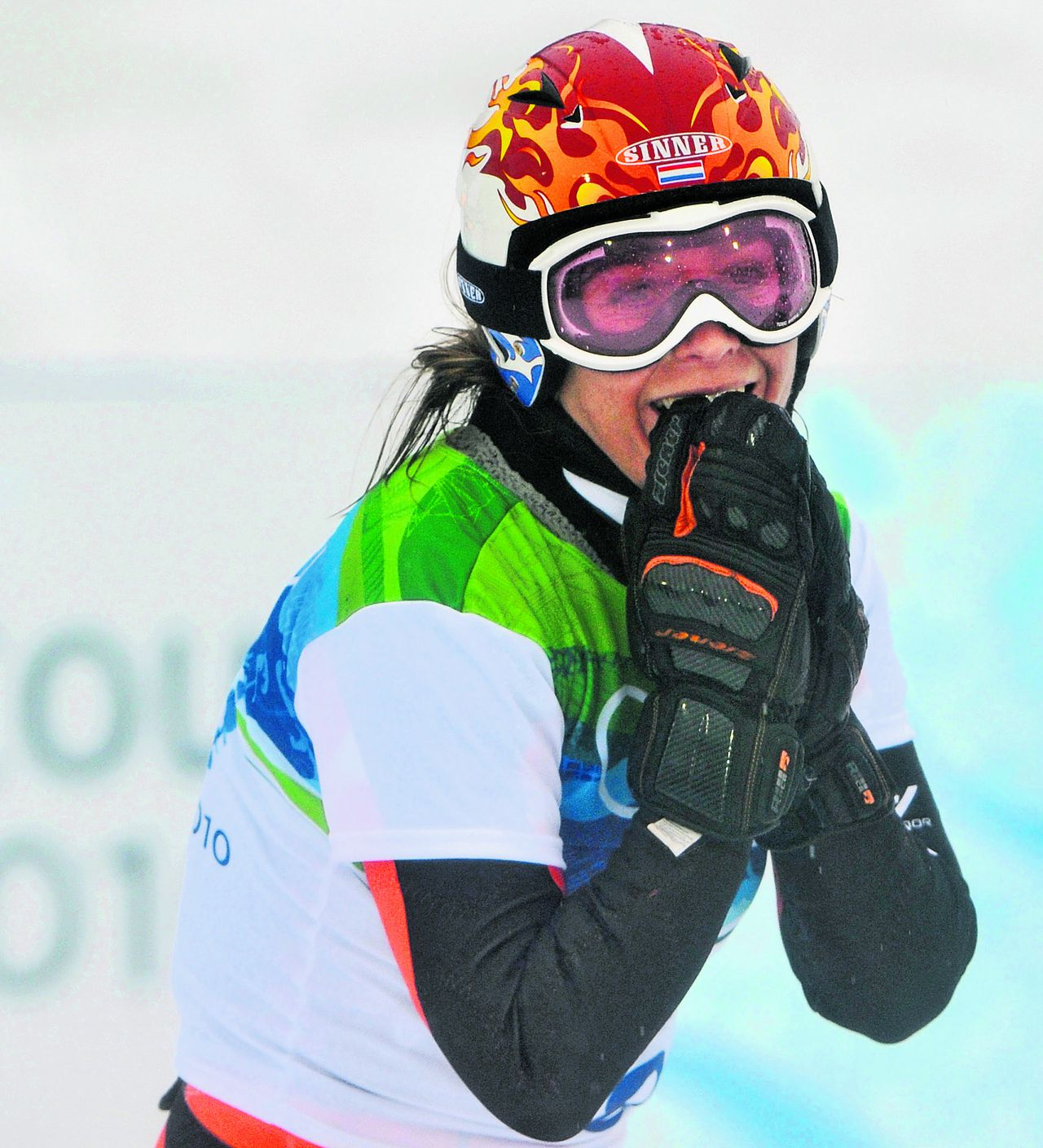 Olympic champion Nicolien Sauerbreij of Holland reacts after winning the women's Parallel Giant Slalom snowboarding competition at the Vancouver 2010 Olympics in Vancouver, British Columbia, Friday, Feb. 26, 2010. (AP Photo/Bela Szandelszky)