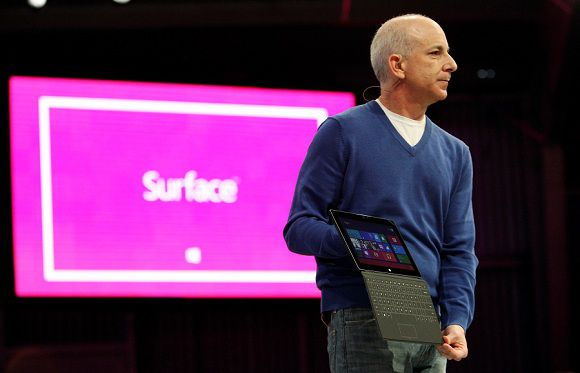 Caption: President of the Windows and Windows Live Division Steven Sinofsky holds the new Surface tablet computer during his presentation, as it is unveiled in Los Angeles, California, June 18, 2012. Microsoft Corp introduced its own line of tablet computers on Monday at a media event in Los Angeles, marking a major strategic shift for the software giant as it struggles to compete with Apple Inc and re-invent its aging Windows franchise. REUTERS/David McNew (UNITED STATES - Tags: BUSINESS SCIENCE TECHNOLOGY)