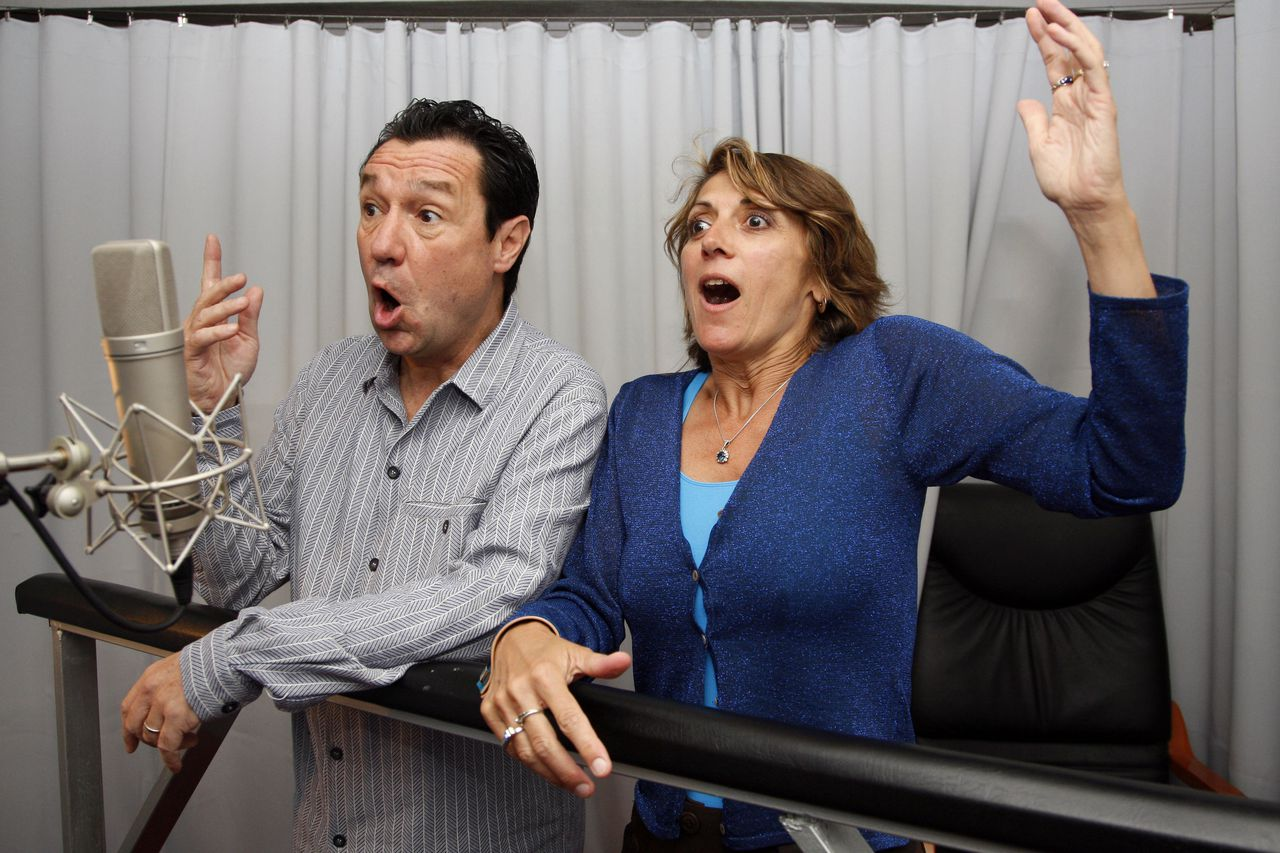 "French actors Philippe Peythieu and Veronique Augereau gesture, 11 July 2007 in a recording studio in Paris, during the dubbing session for the French version of the US series ""The Simpsons""."