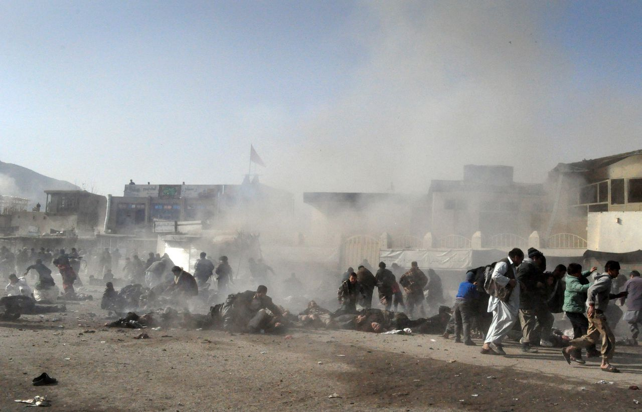 EDS NOTE: GRAPHIC CONTENT - Smoke and dust rises at the scene of a suicide attack which struck a Muharram procession in Kabul, Afghanistan, Tuesday, Dec. 6, 2011. A suicide bomber struck a crowd of Shiite worshippers marking a holy day Tuesday in the Afghan capital as scores of people were killed in an unprecedented wave of violence against the minority Islamic sect in Afghanistan. (AP Photo)