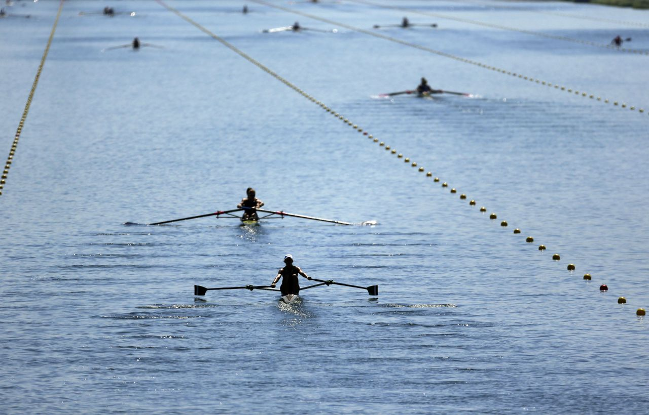 Rowers practice before the 2012 Summer Olympics, Tuesday, July 24, 2012, in Eton Dorney, near Windsor, England. The opening ceremonies for the 2012 London Olympics will be held Friday, July 27. (AP Photo/Natacha Pisarenko)