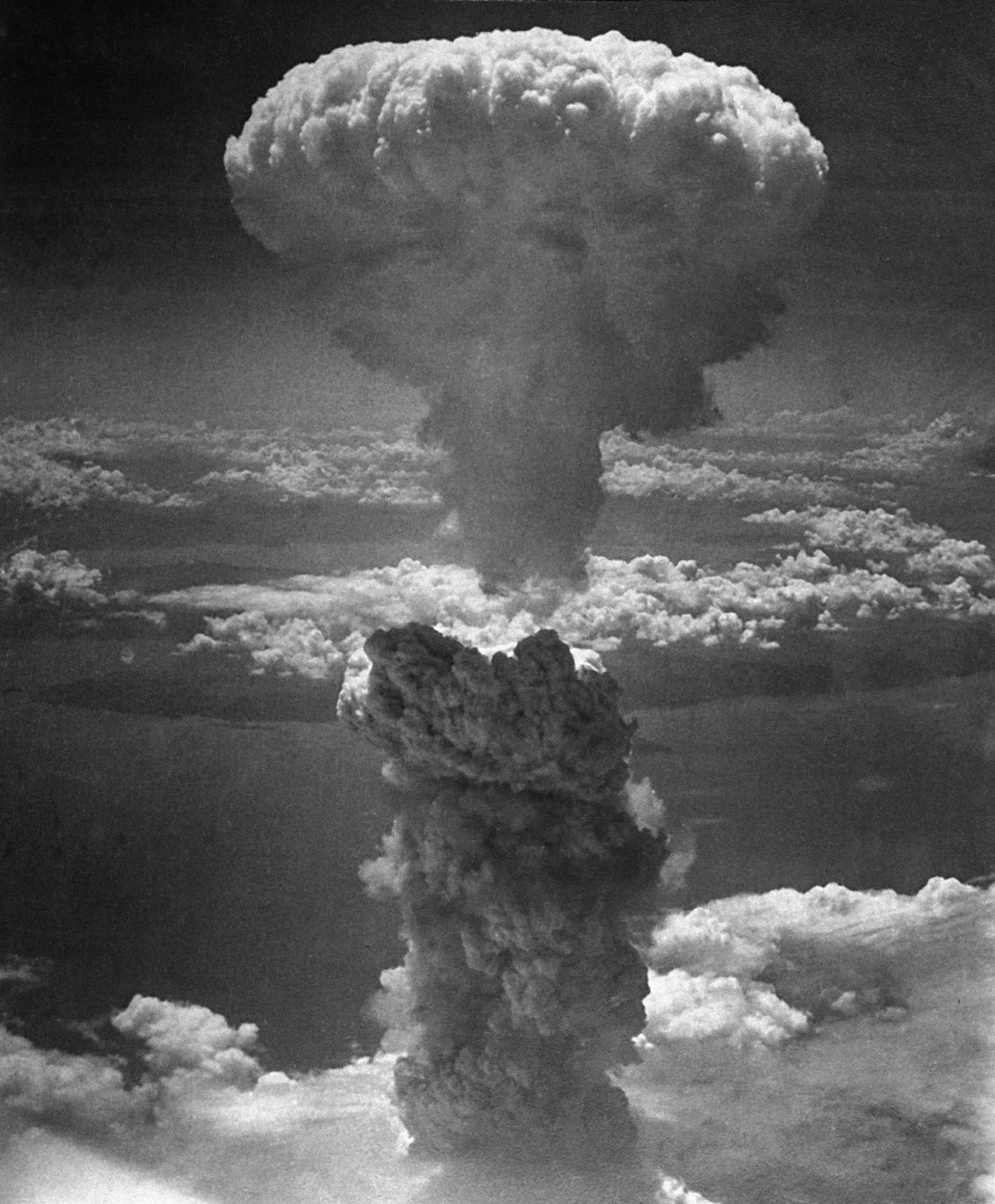 ** FILE - In this Aug. 9, 1945 black-and-white photo provided by the U.S. Air Force, a giant column of dark smoke rises more than 20,000 feet into the air, after the second atomic bomb ever used in warfare explodes over Nagasaki, Japan. (AP Photo/USAF)