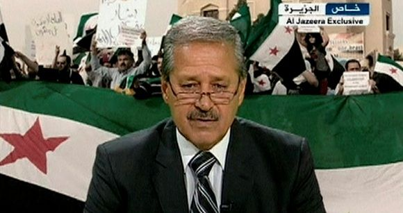Syria's ambassador to Iraq Nawah al-Fares announces his resignation and decision to join the opposition forces against President Bashar al-Assad from an undisclosed location, in this still image taken from video footage July 11, 2012. Fares defected on July 11, 2012 in protest over Assad's violent suppression of a 16-month uprising as the U.N. Security Council remained deadlocked over the next steps in the crisis. MANDATORY CREDIT. REUTERS/Al-Jazeera via Reuters TV (POLITICS CIVIL UNREST CONFLICT) NO SALES. NO ARCHIVES. FOR EDITORIAL USE ONLY. NOT FOR SALE FOR MARKETING OR ADVERTISING CAMPAIGNS. THIS IMAGE HAS BEEN SUPPLIED BY A THIRD PARTY. IT IS DISTRIBUTED, EXACTLY AS RECEIVED BY REUTERS, AS A SERVICE TO CLIENTS. MANDATORY CREDIT. FONTS CANNOT BE OBSTRUCTED OR COVERED