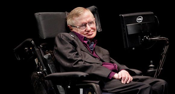 Caption: Physicist and best-selling author Stephen Hawking appears, Saturday, June 16, 2012, in Seattle. Hawking was taking part in the Seattle Science Festival Luminaries Series. (AP Photo/Ted S. Warren)