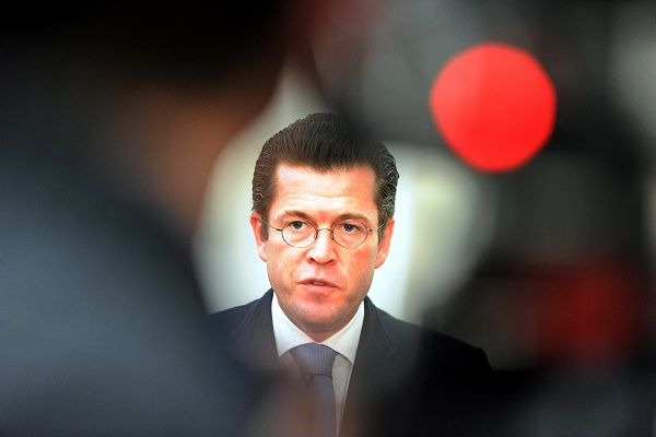 """German Defence Minister Karl-Theodor zu Guttenberg addresses a statement on February 18, 2011 at his ministry in Berlin, where the popular defence minister said he was temporarily renouncing his doctorate amid allegations he plagiarised large sectors of his thesis. Karl-Theodor zu Guttenberg told reporters: """"I will temporarily, I repeat temporarily, give up my doctoral title"""" until his former university completes an investigation into the claims. AFP PHOTO / TOBIAS KLEINSCHMIDT GERMANY OUT"""