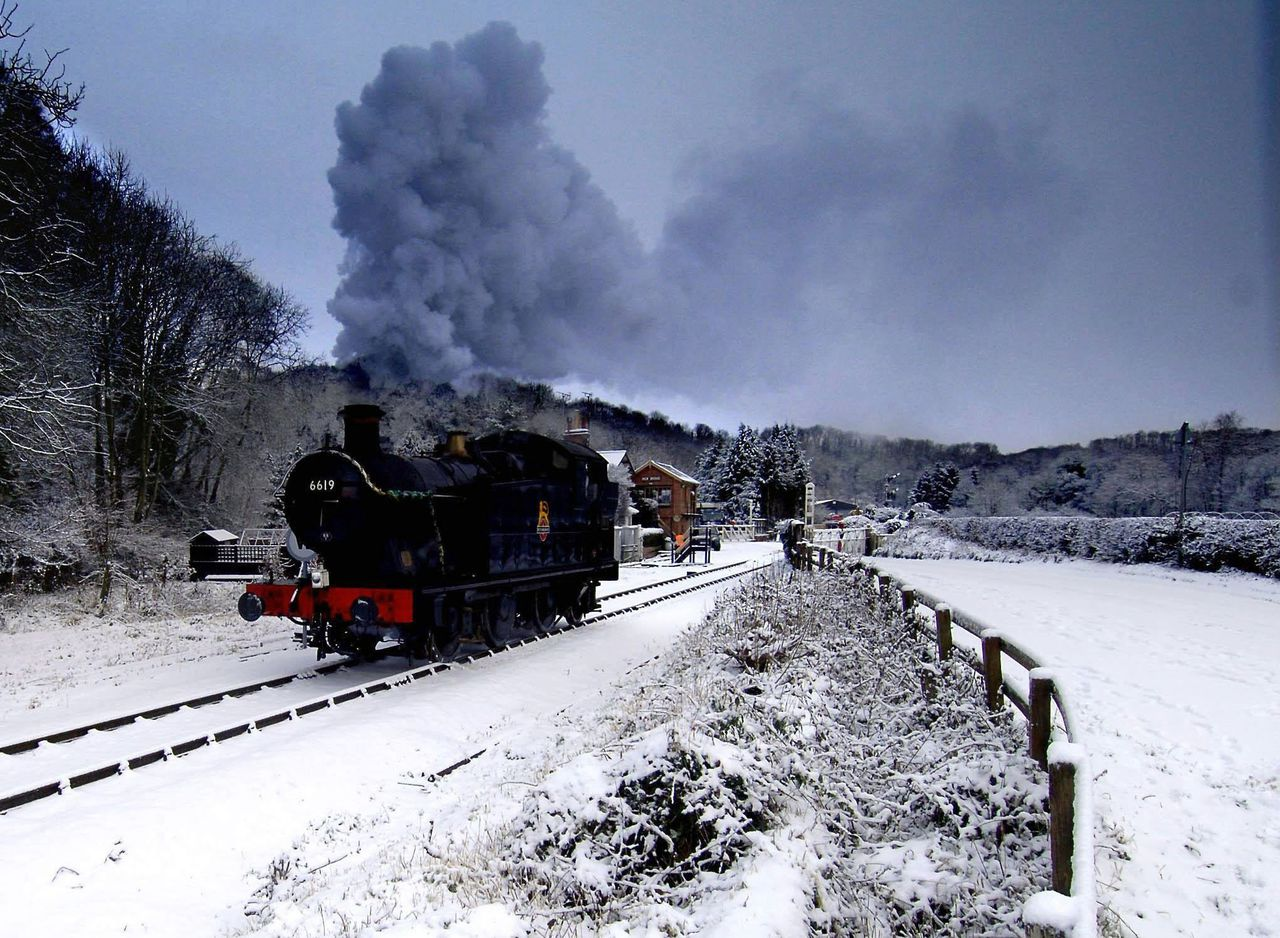 A steam-engine of the North Yorkshire Moors Railway which runs between Pickering and Goathland, in northeastern England steams from the countryside despite heavy snowfall on Wednesday Dec. 28, 2005. Eastern parts of Britain have been hit by snowfalls for a second day, with more bad weather forecasted for Thursday. (AP Photo/ John Giles/PA) ** UNITED KINGDOM OUT NO SALES NO ARCHIVE **