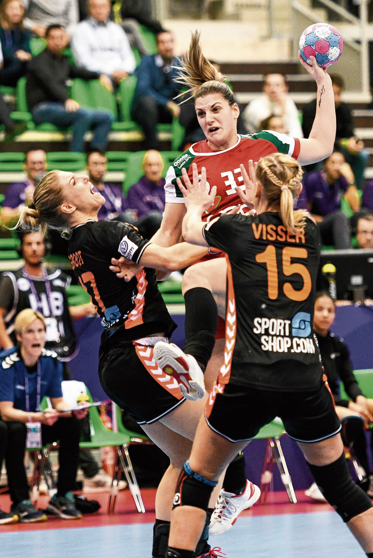 Hungarian right back Anna Kovacs (2ndR) vies with Dutch center back Nycke Groot (L) and Dutch center back Maura Visser (R) during the Women Euro 2018 handball Championships group C preliminary round match between Hungary vs Netherlands on December 1, 2018 at the Axone arena in Montbeliard. (Photo by SEBASTIEN BOZON / AFP)