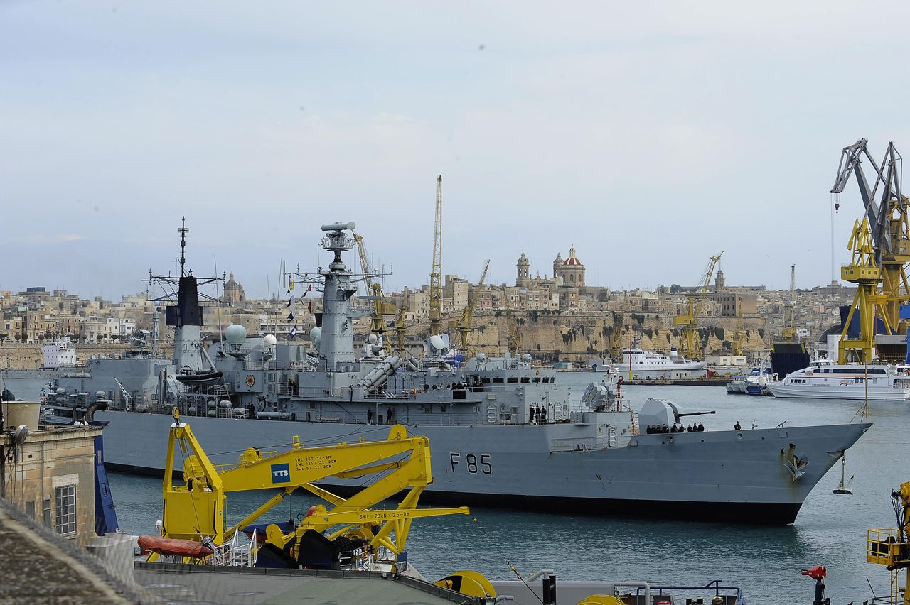 The British Royal Navy frigate HMS Cumberland enters Valletta harbor, Malta, before docking Monday, Feb. 28, 2011, after returning from Benghazi, Libya, where it rescued some 200 civilians in its second emergency mission. As tens of thousands of foreigners sought to flee fighting in Libya, European countries scrambled to send more ships and military planes to the North African nation.. (AP Photo/Lino Arrigo Azzopardi)