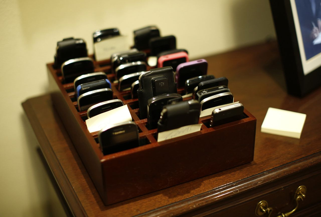 The smartphones belonging to members of President Barack Obama's cabinet are pictured in a storage box outside the room during their first cabinet meeting of the second term at the White House in Washington, March 4, 2013. REUTERS/Jason Reed (UNITED STATES - Tags: POLITICS)