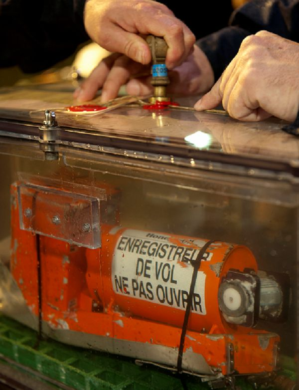Caption: This photo provided Tuesday May 3, 2011 by France's air accident investigation agency, the BEA, shows a sealed flight data recorder from the 2009 Air France flight that went down in the mid-Atlantic. French investigators have found and recovered the cockpit voice recorder from a 2009 Air France flight that plunged into the Atlantic Ocean, killing all 228 on board, the agency that probes air accidents said Tuesday. The machine that records cockpit conversations was located on Monday and raised from the ocean depths on Tuesday, a statement by the agency said. Investigators hope that the black box will help determine what caused the June 1, 2009 crash of Flight 447 from Rio de Janeiro, Brazil, to the French capital, Paris. (AP Photo/BEA, Johann PESCHEL) NO SALES