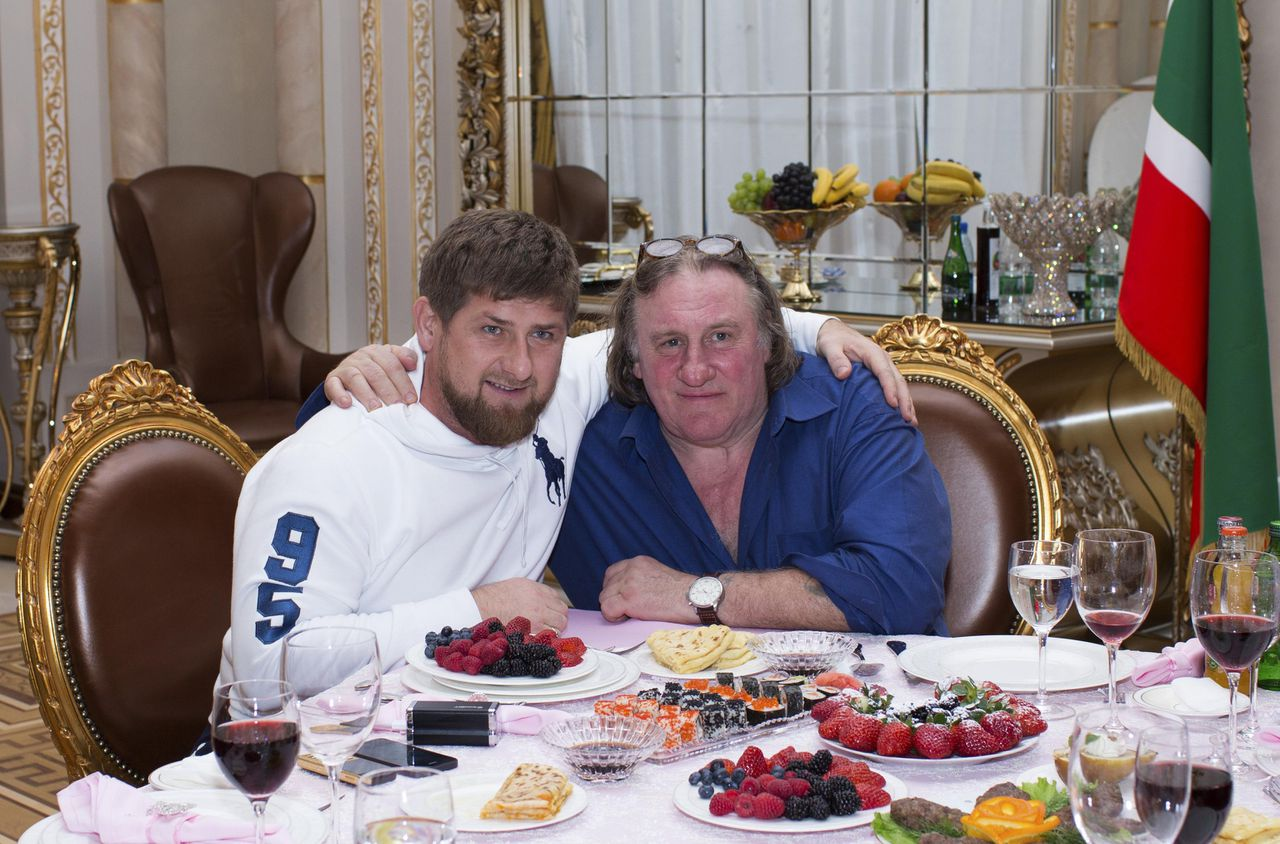 Actor Gerard Depardieu (R) poses for a picture with Chechen President Ramzan Kadyrov during a meeting at the presidential residence as he visits the capital of the Chechen Republic Grozny February 25, 2013. REUTERS/Rasul Yarichev (RUSSIA - Tags: ENTERTAINMENT POLITICS)