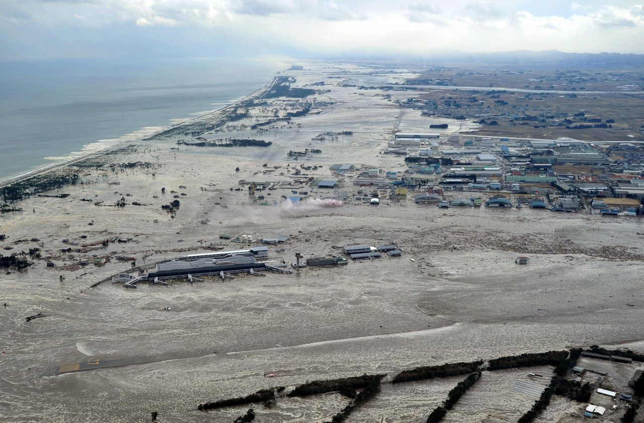 Earthquake-triggered tsunami sweeps the shore as Sendai Airport is surrounded by waters in Miyagi prefecture (state), Japan, Friday, March 11, 2011. The ferocious tsunami spawned by one of the largest earthquakes ever recorded slammed Japan's eastern coasts. (AP Photo/Kyodo News) JAPAN OUT, MANDATORY CREDIT, FOR COMMERCIAL USE ONLY IN NORTH AMERICA