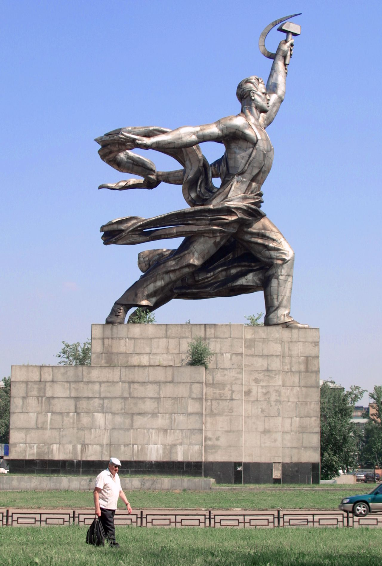 """The famous Soviet statue """"A Worker and a Female Collective Farmer"""" by Vera Mukhina, is pictured here in Moscow, 18 July 2001. This statue was created for the Agricultural Exhibition in Paris in 1937, and was mounted at the top of the Soviet pavilion. The sculpture group is considered to be a symbol of Soviet monumental art and socialist realizm, official, state-supported art trend in the Soviet Union."""