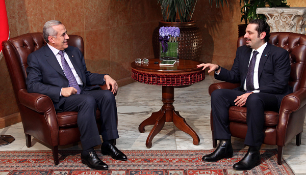 Lebanese President Michel Suleiman, left, meets with caretaker Prime Minister Saad Hariri,right, at the Presidential Palace in Baabda, east of Beirut, Lebanon, Friday, Jan. 14, 2011. Hariri returned home Friday to a deepening political crisis two days after a Hezbollah-led coalition toppled his Western-backed government. (AP Photo/Bilal Hussein)
