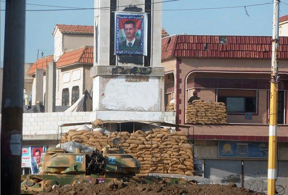 Caption: A tank is seen at an army checkpoint at a square in Hula near Homs October 10, 2011. At least 31 people were killed across Syria in the latest wave of violence, notably clashes between gunmen believed to be army deserters and troops loyal to President Bashar al-Assad, a Syrian activist group said on Monday. Picture taken October 10, 2011. REUTERS/Handout (SYRIA - Tags: POLITICS MILITARY) FOR EDITORIAL USE ONLY. NOT FOR SALE FOR MARKETING OR ADVERTISING CAMPAIGNS. THIS IMAGE HAS BEEN SUPPLIED BY A THIRD PARTY. IT IS DISTRIBUTED, EXACTLY AS RECEIVED BY REUTERS, AS A SERVICE TO CLIENTS