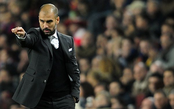 FC Barcelona's coach Josep Guardiola gestures against Athletic Bilbao during a Spanish La Liga soccer match at the Camp Nou stadium in Barcelona, Spain, Sunday, Feb. 20, 2011. (AP Photo/Manu Fernandez)
